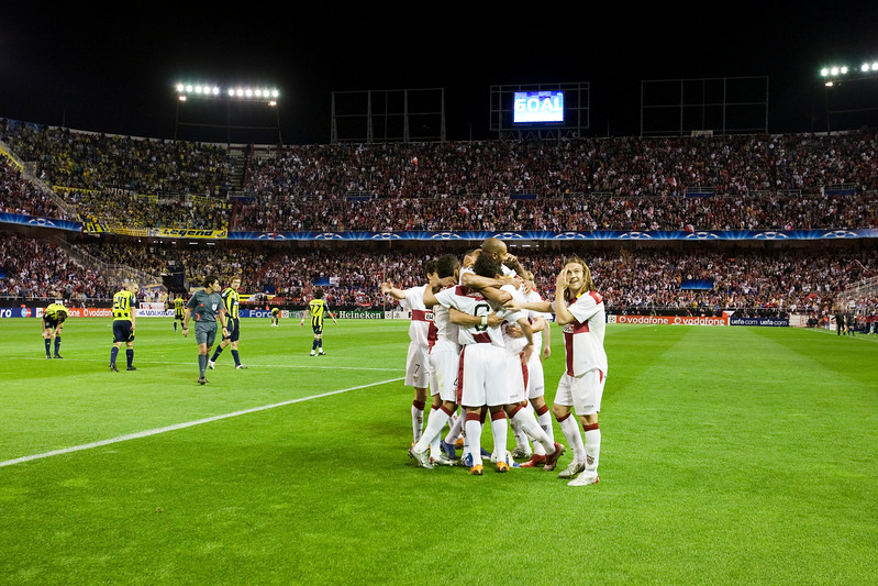Sevilla FC players celebrating a goal. UEFA Champions League first knockout round game (second leg) between Sevilla FC (Seville, Spain) and Fenerbahce (Istambul, Turkey), Sanchez Pizjuan stadium, Seville, Spain, 04 March 2008.