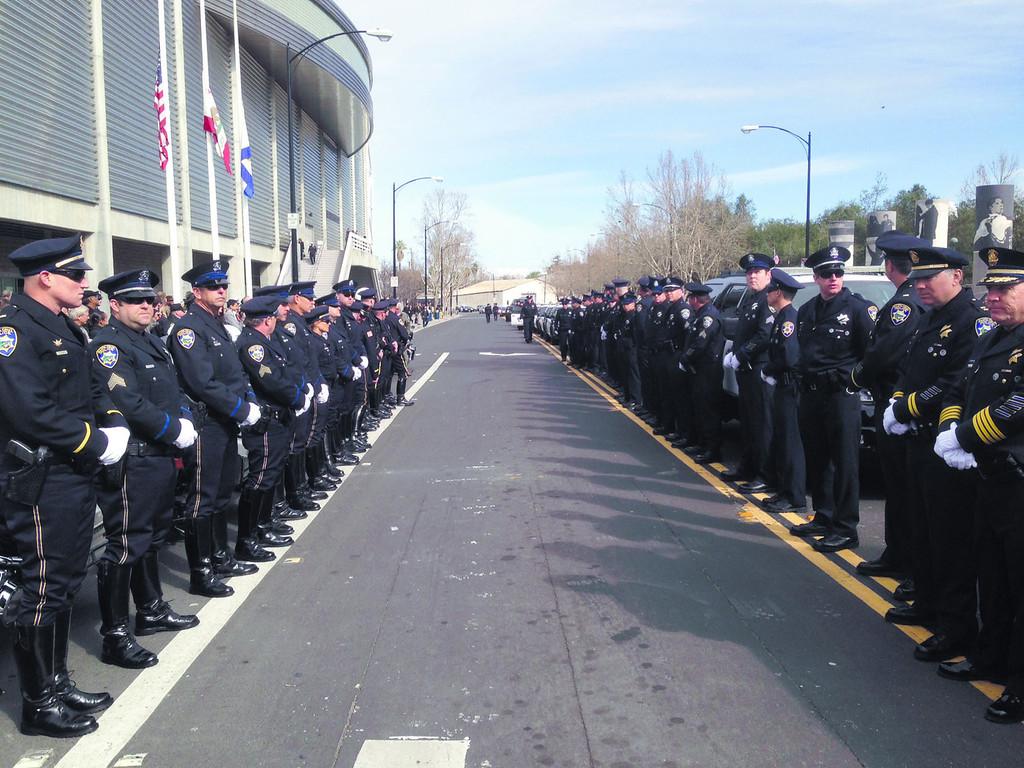 . Officers line a path outside HP Pavilion in San Jose, Calif., on Thursday, March 7, 2013. (Shmuel Thaler/Santa Cruz Sentinel)