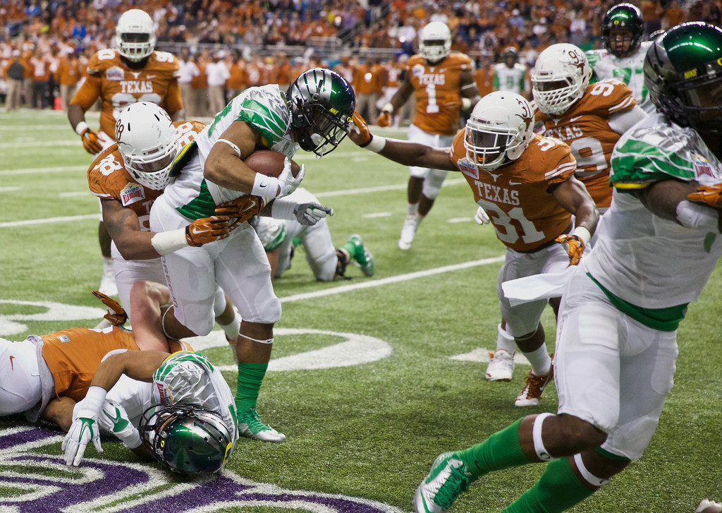 . Oregon Ducks running back Thomas Tyner (24), runs against the Texas Longhorns in the Valero Alamo Bowl in San Antonio,  during the NCAA college football game at the Alamodome, Mon, Dec 30, 2013. (AP Photo/The Oregonian, Thomas Boyd)