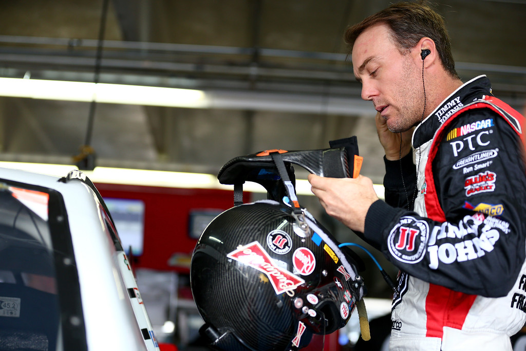 . CONCORD, NC - OCTOBER 11:  Kevin Harvick, driver of the #29 Jimmy John\'s Chevrolet, stands in the garage area during practice for the NASCAR Sprint Cup Series Bank of America 500 at Charlotte Motor Speedway on October 11, 2013 in Concord, North Carolina.  (Photo by Streeter Lecka/Getty Images)