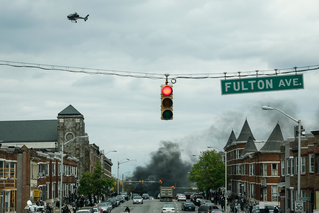 . BALTIMORE, MD - APRIL 27:  Smoke billows at the intersection of Pennsylvania Avenue and North Avenue (seen from Fulton Ave), April 27, 2015 in Baltimore, Maryland. Riots have erupted in Baltimore following the funeral service for Freddie Gray, who died last week while in Baltimore Police custody. (Photo by Drew Angerer/Getty Images)