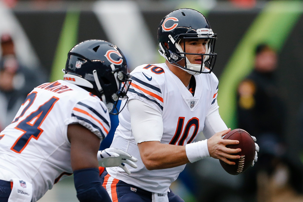 . Chicago Bears quarterback Mitchell Trubisky (10) hands off the ball to running back Jordan Howard (24) who runs in for a touchdown in the first half of an NFL football game against the Cincinnati Bengals, Sunday, Dec. 10, 2017, in Cincinnati. (AP Photo/Gary Landers)