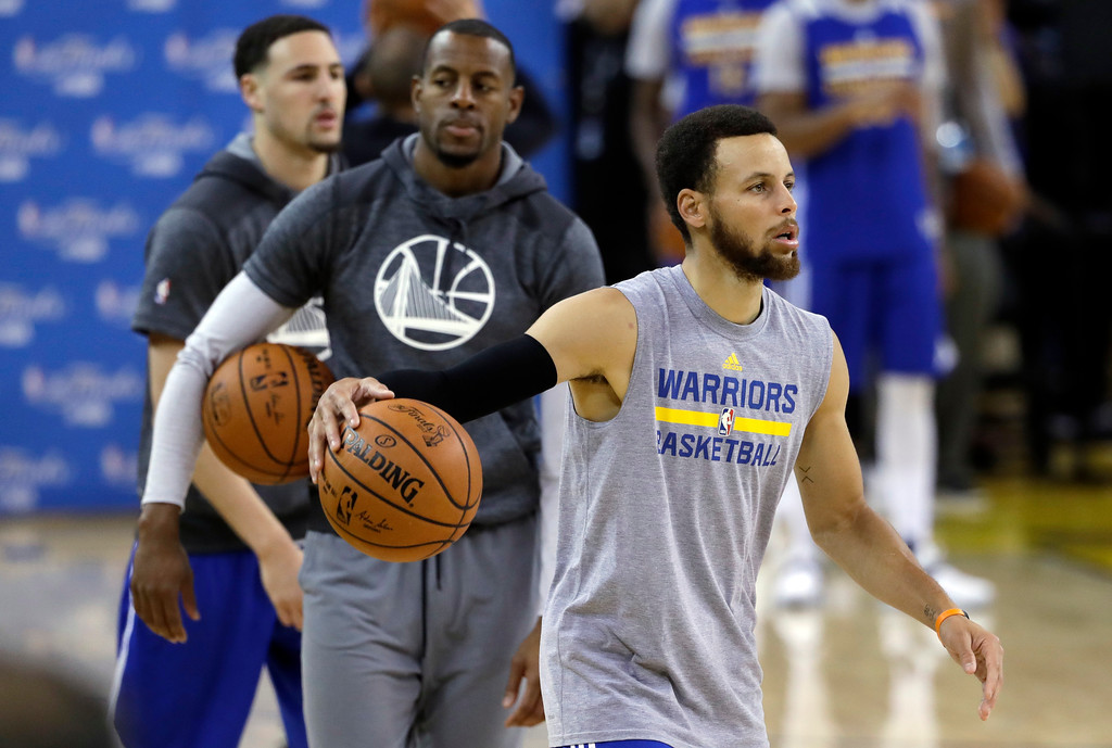 . From right, Golden State Warriors\' Stephen Curry, Andre Iguodala and Klay Thompson line up to shoot during an NBA basketball practice, Wednesday, May 31, 2017, in Oakland, Calif. The Golden State Warriors face the Cleveland Cavaliers in Game 1 of the NBA Finals on Thursday in Oakland. (AP Photo/Marcio Jose Sanchez)