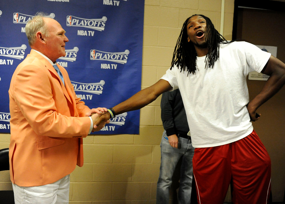. Denver Nuggets head coach, George Karl, sporting a Kentucky Derby outfit, has a laugh with player, Kenneth Faried, after Karl spoke with reporters Saturday afternoon at Pepsi Center, a day after Nuggets defeated the Los Angeles Lakers in game three of the first round of the NBA 2012 playoffs. Coach Karl headed to a Derby party/benefit after the press conference. Andy Cross, The Denver Post