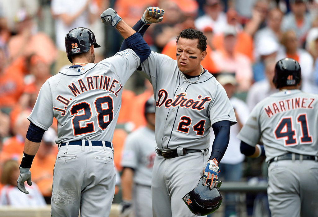 . Detroit Tigers\' J.D. Martinez (28) greets teammate Miguel Cabrera after batting Cabrera and Victor Martinez (41) in on a home run in the fourth inning of Game 2 in baseball\'s AL Division Series against the Baltimore Orioles in Baltimore, Friday, Oct. 3, 2014. (AP Photo/Nick Wass)