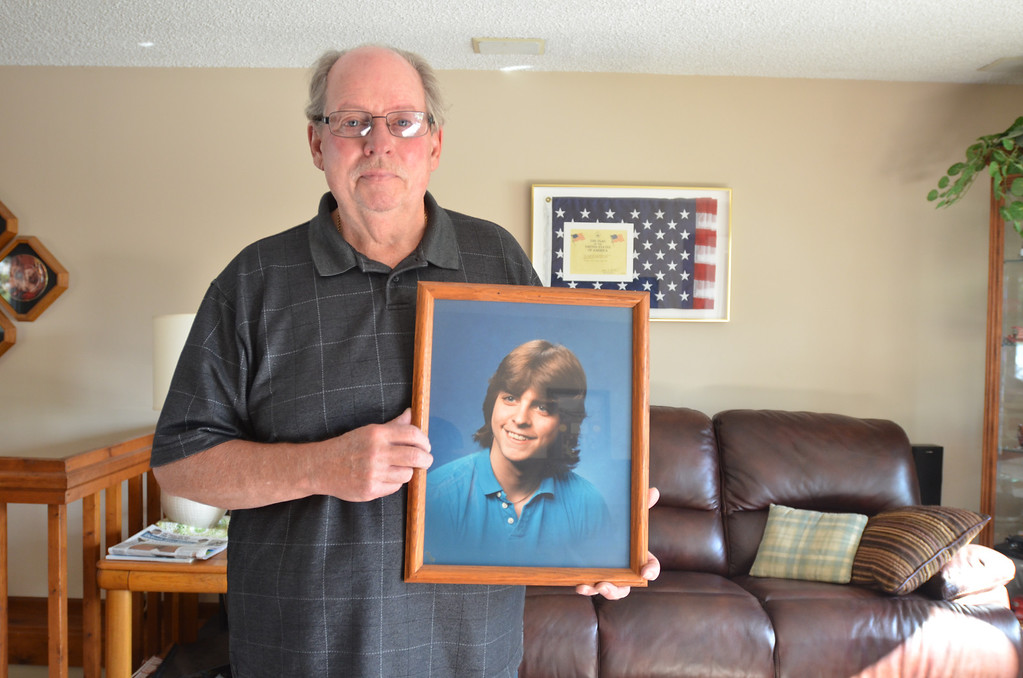. Robert Willett of Waterford Township displays a photo of his son, Kenneth Willett, who was killed in a car crash involving former Detroit Lions player Reggie Rogers, Oct. 20, 1988. The Oakland Press/AFTAB BORKA