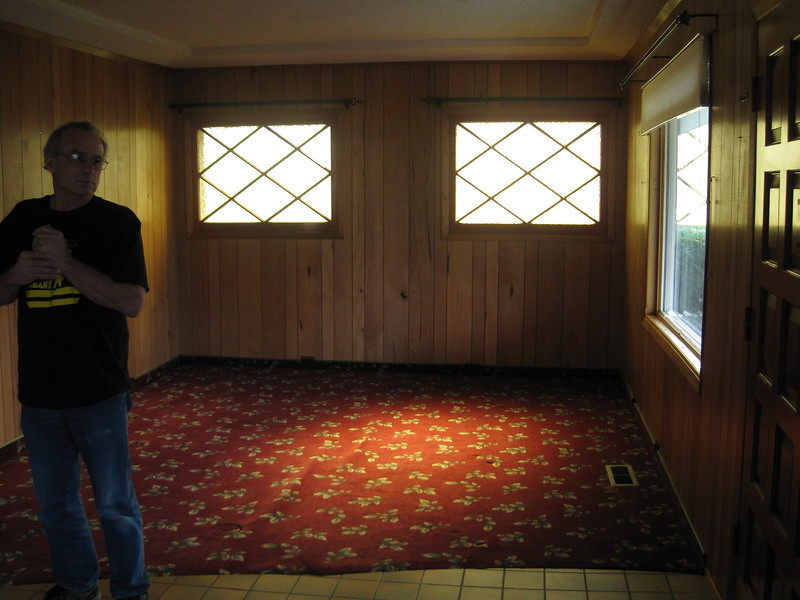 looking right from the door into the LR --- with yellow stain glass windows!!