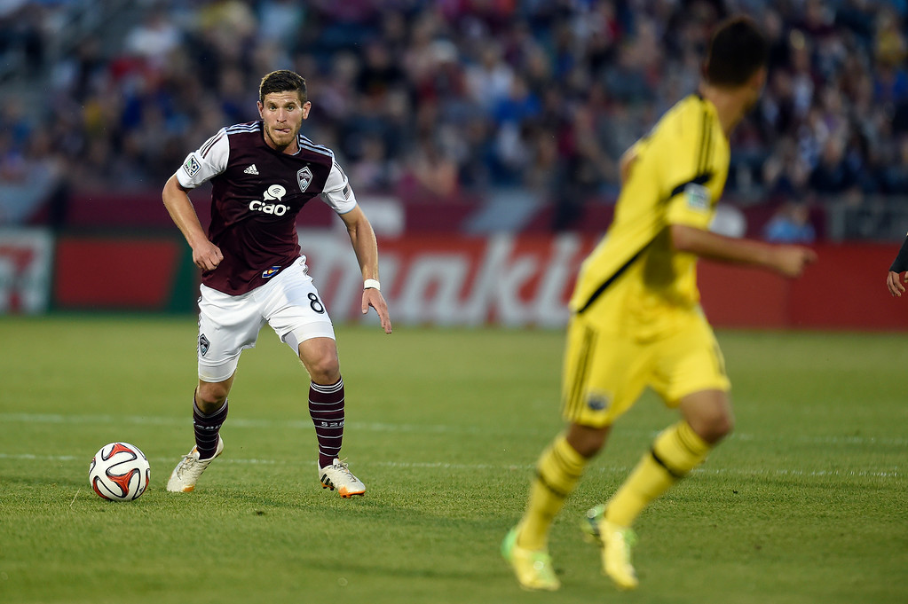 . Dillon Powers #8 of the Colorado Rapids looks to dribble the ball against the Columbus Crew in the second half of an MLS match at Dick\'s Sporting Goods Park on July 4, 2014, in Commerce City, Colorado. (Photo by Daniel Petty/The Denver Post)
