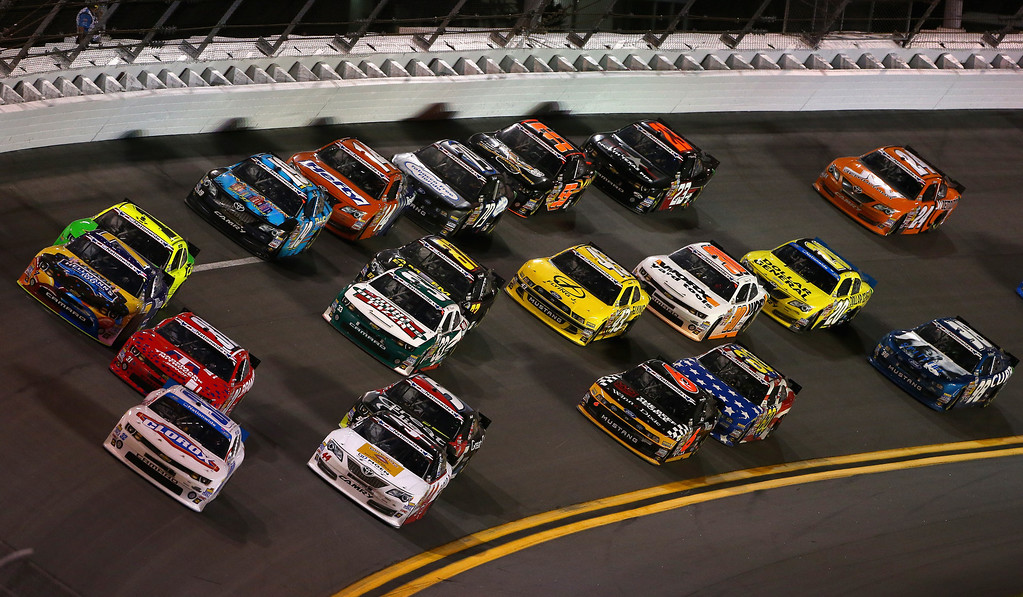 . DAYTONA BEACH, FL - JULY 05:  Nelson Piquet Jr., driver of the #30 Worx Chevrolet, leads the field during the NASCAR Nationwide Series Subway Firecracker 250 at Daytona International Speedway on July 5, 2013 in Daytona Beach, Florida.  (Photo by Todd Warshaw/Getty Images)