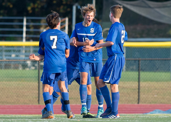 10/01/19 Wesley Bunnell | StaffrrSouthington boys soccer was defeated by Avon 3-2 on Tuesday afternoon at Southington High School. Cole Marek (12) is greeted by teammates after tying the game at 2 in the second half.