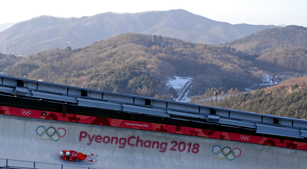 . Wojciech Chmielewski and Jakub Kowalewski, of Poland, take a practice run during the men\'s doubles luge training at the 2018 Winter Olympics in Pyeongchang, South Korea, Monday, Feb. 12, 2018. (AP Photo/Charlie Riedel)