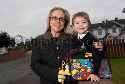 Ethan Goss pictured with his mum Colette leaving for his 1st day at Ballyholland Primary School. R1436002