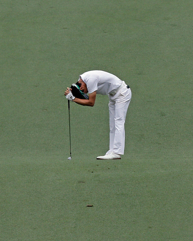 . Ryo Ishikawa, of Japan, reacts to his second shot on the seventh hole during the fourth round of the Masters golf tournament Sunday, April 14, 2013, in Augusta, Ga. (AP Photo/David J. Phillip)