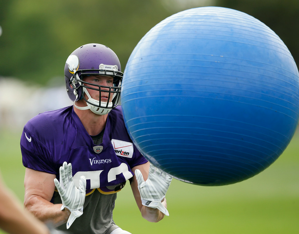 . Minnesota Vikings tight end Kyle Rudolph participates in a drill during NFL football training camp, Sunday, July 27, 2014, in Mankato, Minn. (AP Photo/Charlie Neibergall)