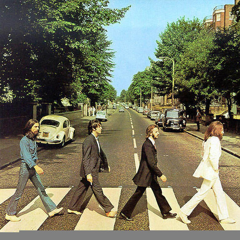 """. January 2003:  The original copy of the Beatles Abbey Road album cover shows Paul McCartney, third in line, holding a cigarette. United States poster companies have airbrushed this image to remove the cigarette from McCartney\'s hand. This change was made without the permission of either McCartney or Apple Records, which owns the rights to the image. \""""We have never agreed to anything like this,\"""" said an Apple spokesman. \""""It seems these poster companies got a little carried away. They shouldn\'t have done what they have, but there isn\'t much we can do about it now.\""""  SOURCE: http://www.cs.dartmouth.edu/farid/research/digitaltampering/"""