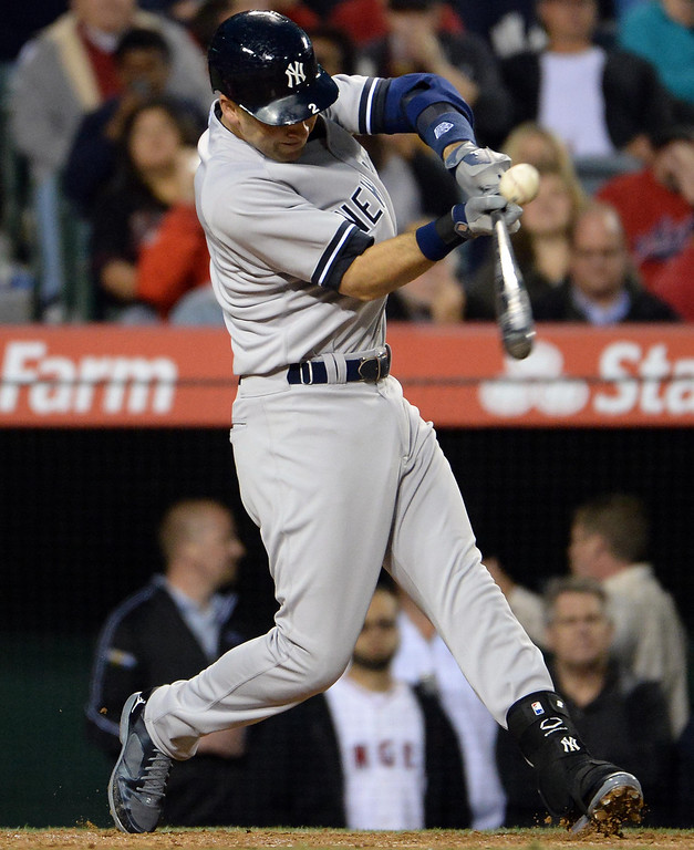 . New York Yankees\' Derek Jeter singles in the third inning of a baseball game against the Los Angeles Angels at Anaheim Stadium in Anaheim, Calif., on Tuesday, May 6, 2014.  (Keith Birmingham Pasadena Star-News)