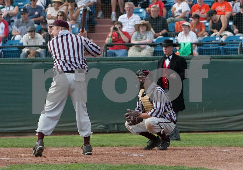 Cigar equipped throughout the game,  the umpire positioned himself to be able to face each batter and call the pitches.
