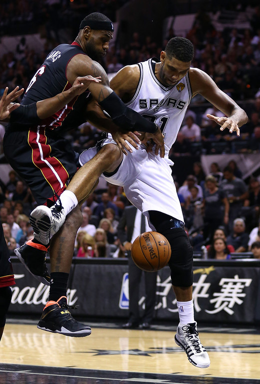 . LeBron James #6 of the Miami Heat and Tim Duncan #21 of the San Antonio Spurs battle for a rebound during Game Two of the 2014 NBA Finals at the AT&T Center on June 8, 2014 in San Antonio, Texas.  (Photo by Andy Lyons/Getty Images)