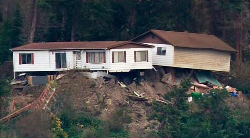 . Homes sit damaged after a landslide on Whidbey Island, Washington in this frame grab taken from video courtesy of KING 5 News, March 27, 2013. The landslide, which occurred early morning March 27, heavily damaged one home and is threatening over 30 others in the community of Ledgewood. REUTERS/KING 5 News/Handout