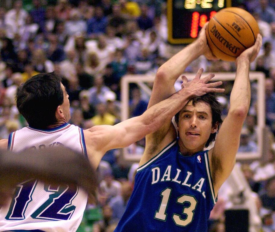 . Utah Jazz guard John Stockton, left, pressures Dallas Mavericks guard Steve Nash during the first quarter Thursday, May 3, 2001, in Salt Lake City. (AP Photo/Kent Horner)