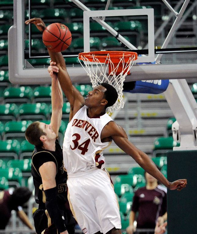 . Denver\'s Chris Udofia (34) blocks a shot by Texas State\'s Reid Koenen during the second half of a Western Athletic Conference tournament NCAA college basketball game on Thursday, March 14, 2013, in Las Vegas. Texas State won 72-68. (AP Photo/David Becker)