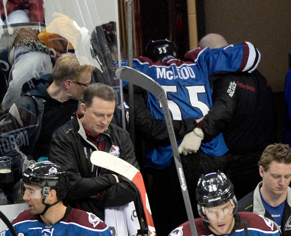 . Cody McLeod was helped to the locker room after he injured his knee in the second period.   (Photo by Karl Gehring/The Denver Post)