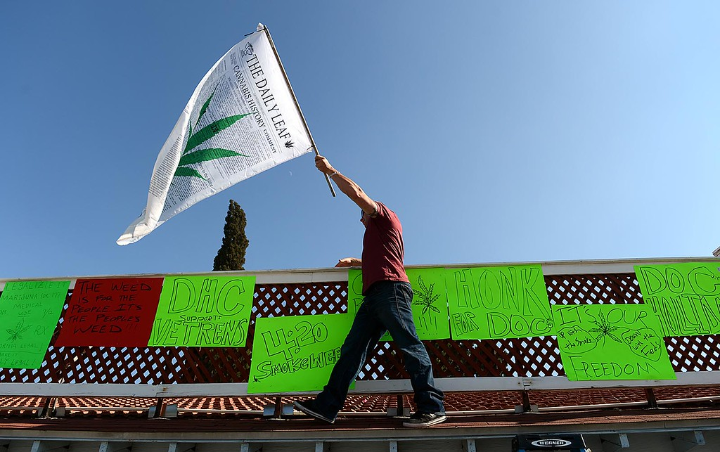 . Luke Luce, owner of  Doc Holliday\'s Collective, in Mentone, joined his supporters in protest of the closure of his medical marijuana dispensary Monday August 12, 2013.  (Photo by Rick Sforza/Redlands Daily Facts)