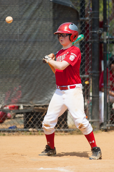 Christopher watches ball four go high in the bottom of the 6th inning. The Nationals played a close and exciting game against the Cubs before being outscored in the 6th inning, losing 8-9. They are now 2-1 for the season. 2012 Arlington Little League Baseball, Majors Division. Nationals vs Cubs (21 Apr 2012) (Image taken by Patrick R. Kane on 21 Apr 2012 with Canon EOS-1D Mark III at ISO 200, f2.8, 1/3200 sec and 300mm)