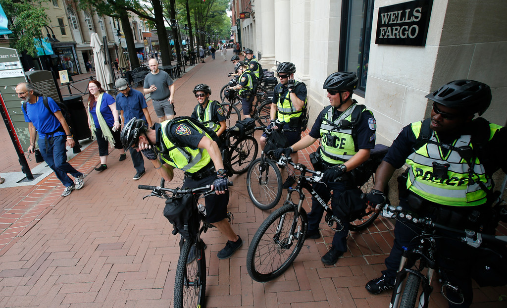 . A Police bike patrol takes a break in the downtown area in anticipation of the anniversary of last year\'s Unite the Right rally in Charlottesville, Va., Saturday, Aug. 11, 2018. State and local authorities framed the weekend\'s heightened security as a necessary precaution. (AP Photo/Steve Helber)