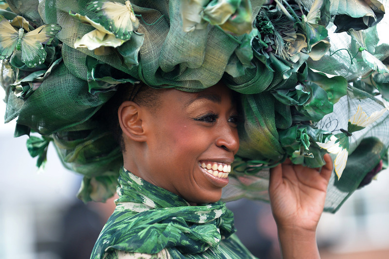 . A racegoer wears a green hat with festooned with butterflies during Ladies Day, the second day of the Grand National Meeting horse racing event at Aintree Racecourse in Liverpool, north-west England on April 5, 2013. The annual three day meeting culminates in the Grand National which is run over a distance of four miles and four furlongs (7,242 metres), and is the biggest betting race in the United Kingdom.  ANDREW YATES/AFP/Getty Images