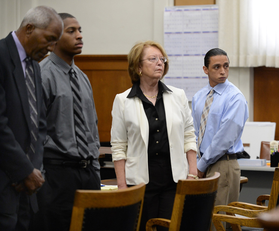 . Defendants Marcelles Peter, second from left, and Jose Montano, far right, along with their attorneys Gordon Brown, far left, and Jane Elliot, second from right, stand as a jury enters the courtroom at the Wakefield-Taylor courthouse in Martinez, Calif., on Thursday, July 18, 2013. Two separate verdicts were read in the Richmond High gang rape trials Marcelles Peter and Jose Montano with Judge Barbara Zuniga presiding. Juries in both cases brought back guilty verdicts. (Dan Honda/Bay Area News Group)