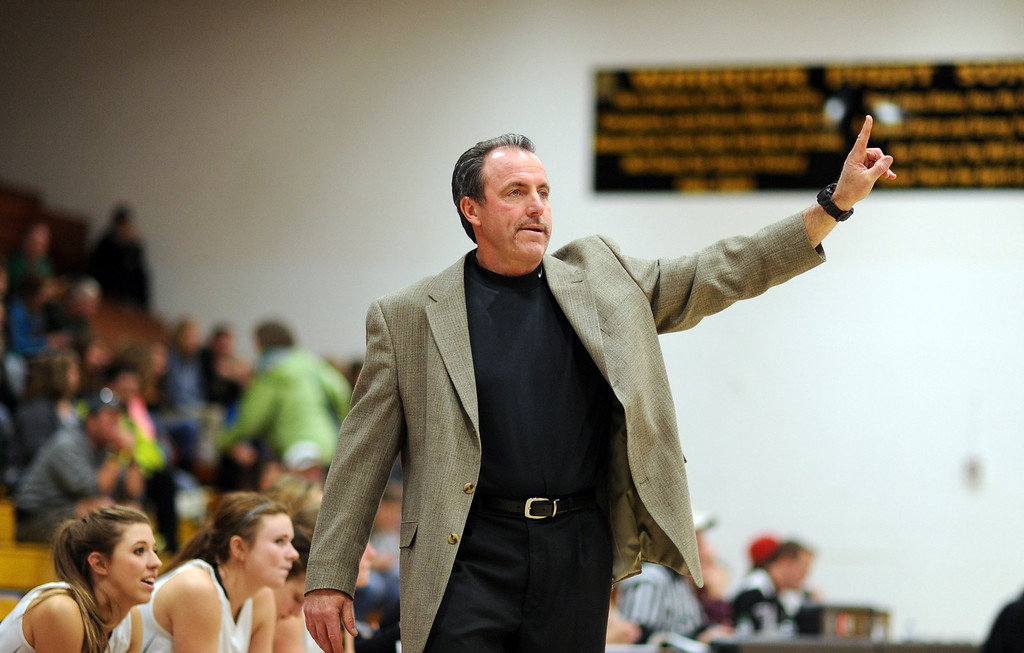 . Arapahoe girls basketball team head coach Jerry Knafelc signals from the sidelines against Mountain Vista at Arapahoe High School Gym onSaturday, Jan. 5, 2013, in Centennial, Colo. Arapahoe won 74-38. Hyoung Chang, The Denver Post