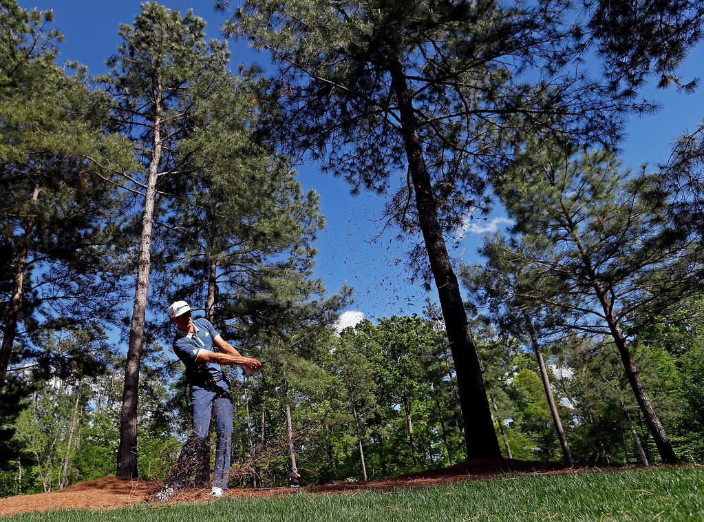 . Dustin Johnson hits out of the rough on the 11th hole during the second round of the Masters golf tournament Friday, April 8, 2016, in Augusta, Ga. (AP Photo/David J. Phillip)