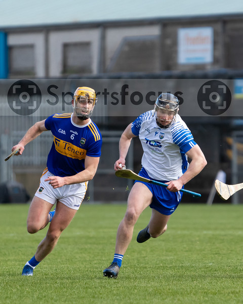 Barry Heffernan of Tipperary gives chase to Waterford's Pauric Mahony