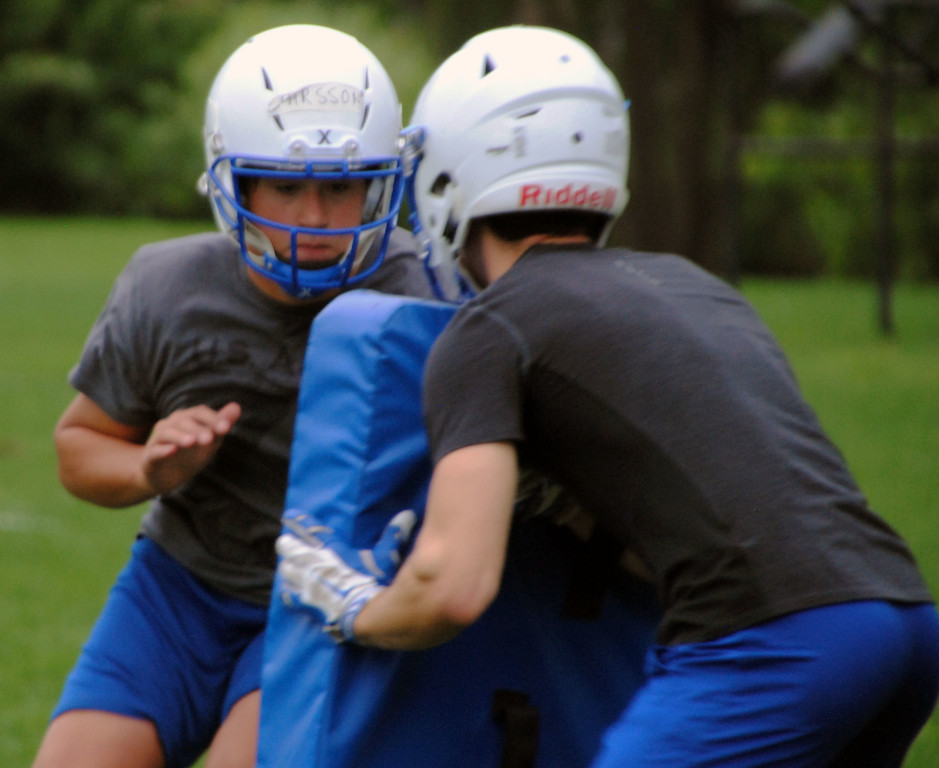 . Jon Behm - The Morning Journal<br> Scenes from Bay\'s first day of football practice on July 30.