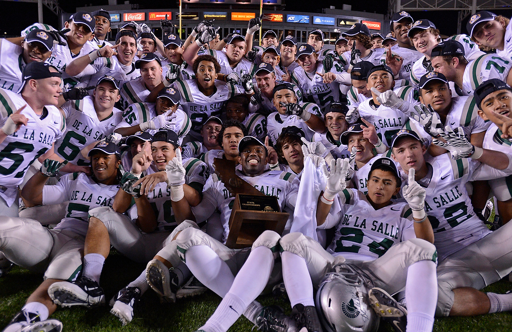 . De La Salle Spartans players celebrate their win over Centennial Huskies in the Open Division during the 2012 CIF State Football Championship at Home Depot Center in Carson , Calif. on Saturday, Dec. 15, 2012. De La Salle defeated Centennial 48-28. (Jose Carlos Fajardo/Staff)