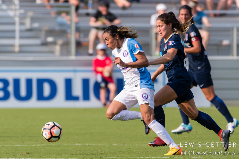 Marta (10) and Sam Witteman (26) during a match between the NC Courage and the Orlando Pride in Cary, NC in Week 3 of the 2017 NWSL season. Photo by Lewis Gettier.
