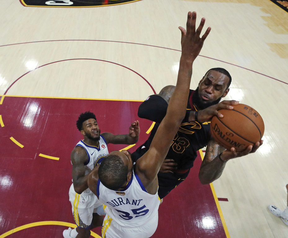 . Cleveland Cavaliers\' LeBron James shoots over Golden State Warriors\' Kevin Durant during the first half of Game 3 of basketball\'s NBA Finals, Wednesday, June 6, 2018, in Cleveland. (Gregory Shamus/Pool Photo via AP)