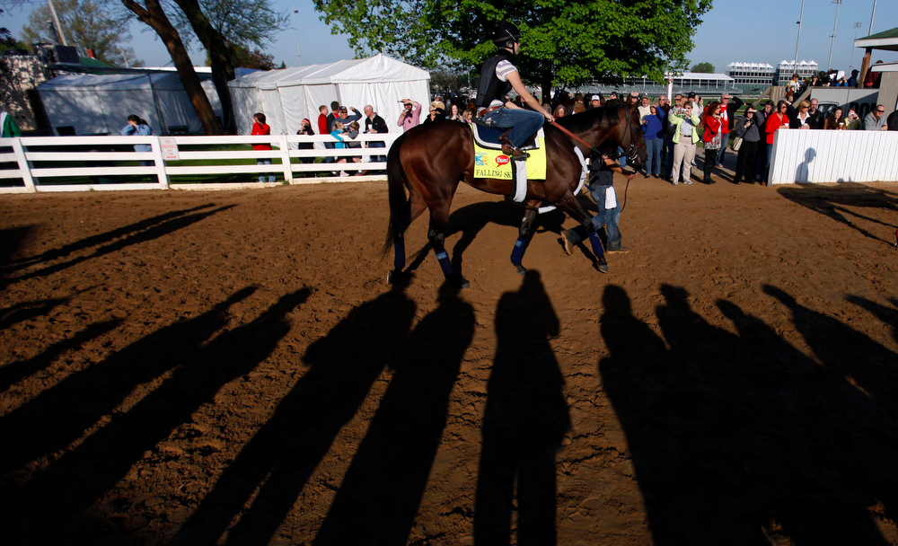 . Exercise rider Cassie Garcea rides Kentucky Derby hopeful Falling Sky for a workout at Churchill Downs Tuesday, April 30, 2013, in Louisville, Ky. (AP Photo/David Goldman)