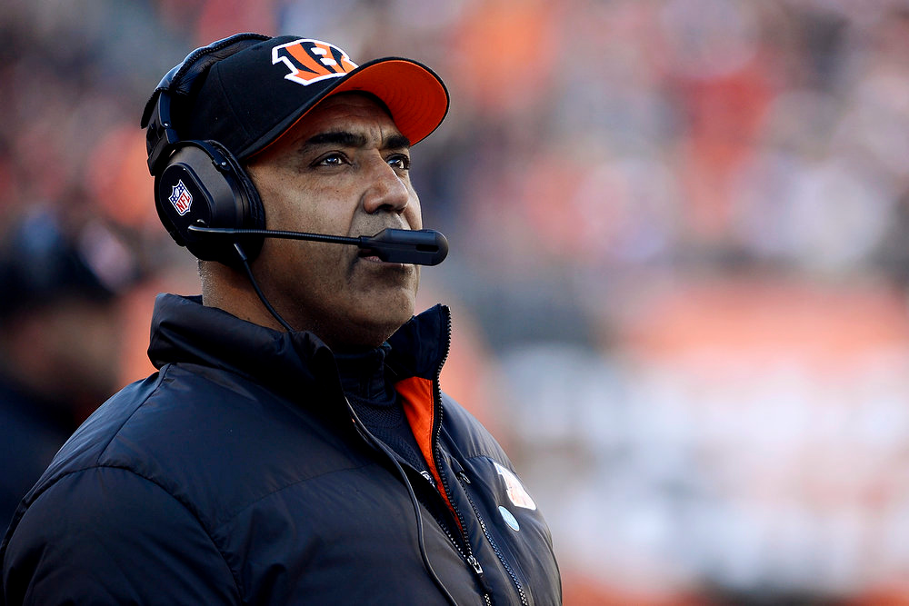 Description of . Cincinnati Bengals head coach Marvin Lewis watches from the sidelines in the first half of an NFL football game against the Baltimore Ravens, Sunday, Dec. 30, 2012, in Cincinnati. (AP Photo/Michael Keating)