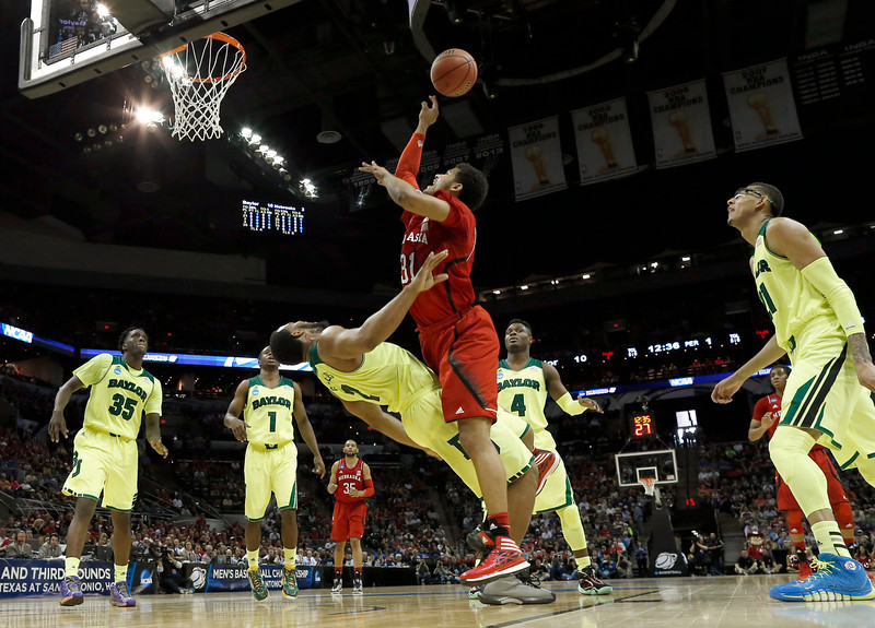 . Baylor\'s Rico Gathers (2) falls backwards as Nebraska\'s Shavon Shields (31) makes contact while shooting during the first half of a second-round game in the NCAA college basketball tournament Friday, March 21, 2014, in San Antonio. Gathers was called for a foul on the play.  (AP Photo/David J. Phillip)