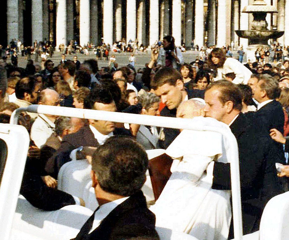 . Alois Estermann, on the left of Pope John Paul II, helps the wounded Pontiff seconds after he was shot in St. Peter\'s Square at the Vatican in this May 13, 1981  photo. Col. Estermann, 43, his Venezuelan wife Gladys Meza Romero and Cedrich Tornay, 23, a non-commissioned officer of the elite corps were found shot to death in Estermann\'s apartment inside the Vatican Monday night, just 12 hours after he was nominated commander of the Swiss Guards by Pope John Paul II. (AP Photo/Arturo Mari)