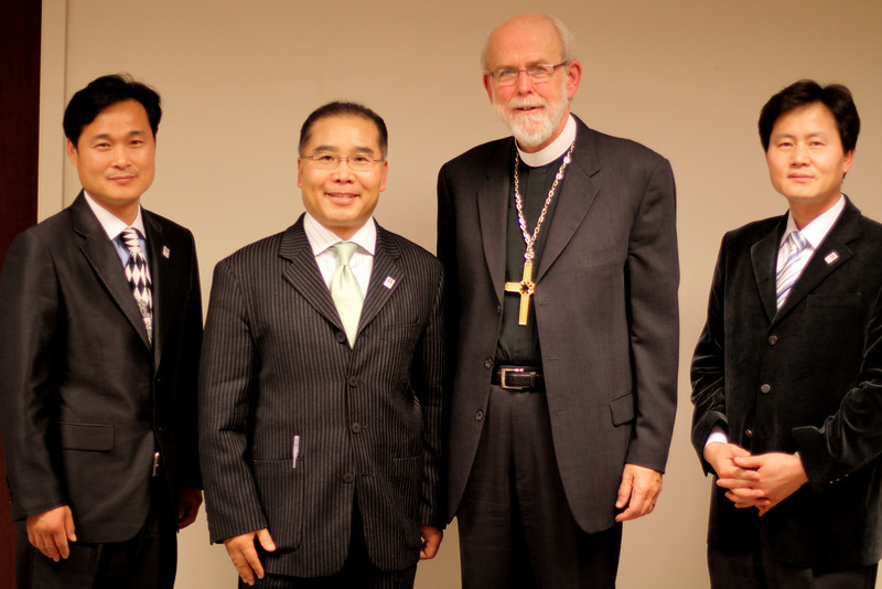 The Rev. Jae-Bum Kim and members of Korean Mission of Good Shepherd Lutheran Church, Naperville with Bishop Hanson.