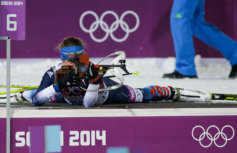 . United States\' Susan Dunklee shoots during the women\'s biathlon 10k pursuit, at the 2014 Winter Olympics, Tuesday, Feb. 11, 2014, in Krasnaya Polyana, Russia. (AP Photo/Gero Breloer)
