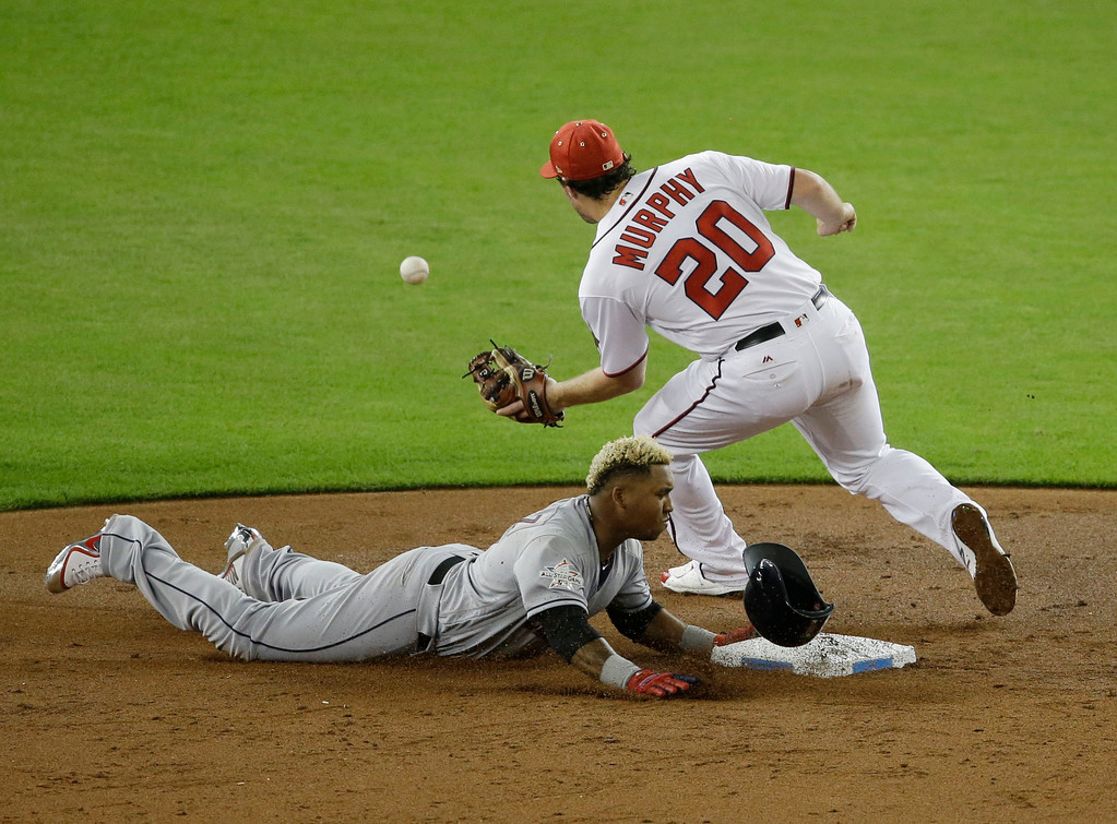 . American League\'s Cleveland Indians José Ramĺrez (11), steals second base as National League\'s Washington Nationals second baseman Daniel Murphy (20) is late with the tag, during the third inning, during the MLB baseball All-Star Game, Tuesday, July 11, 2017, in Miami.(AP Photo/Alan Diaz)