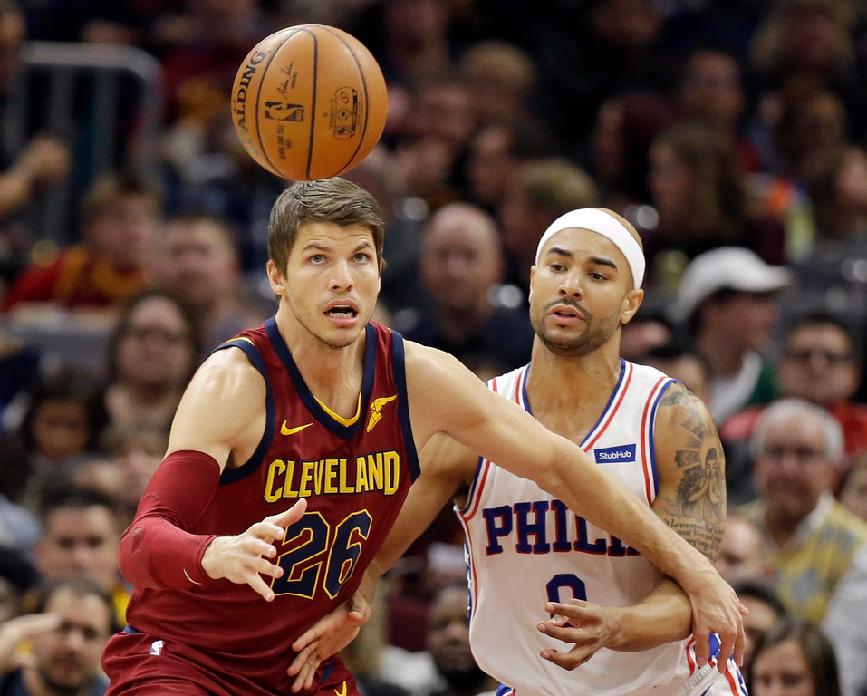 . Cleveland Cavaliers\' Kyle Korver (26) and Philadelphia 76ers\' Jerryd Bayless (0) watch the ball during the first half of an NBA basketball game, Saturday, Dec. 9, 2017, in Cleveland. (AP Photo/Tony Dejak)