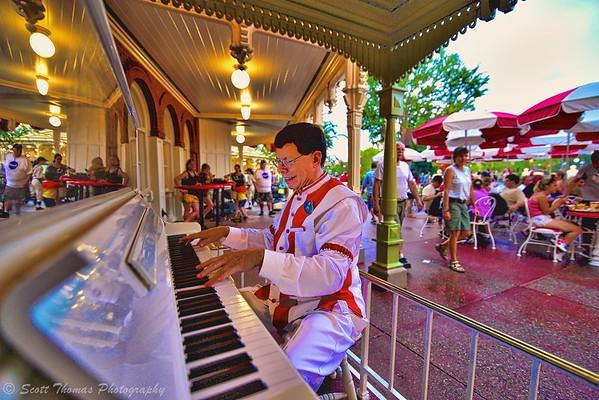 Jim the Ragtime Pianist playing outside Casey's Corner counter service restaurant on Main Street USA in the Magic Kingdom, Walt Disney World, Orlando, Florida.