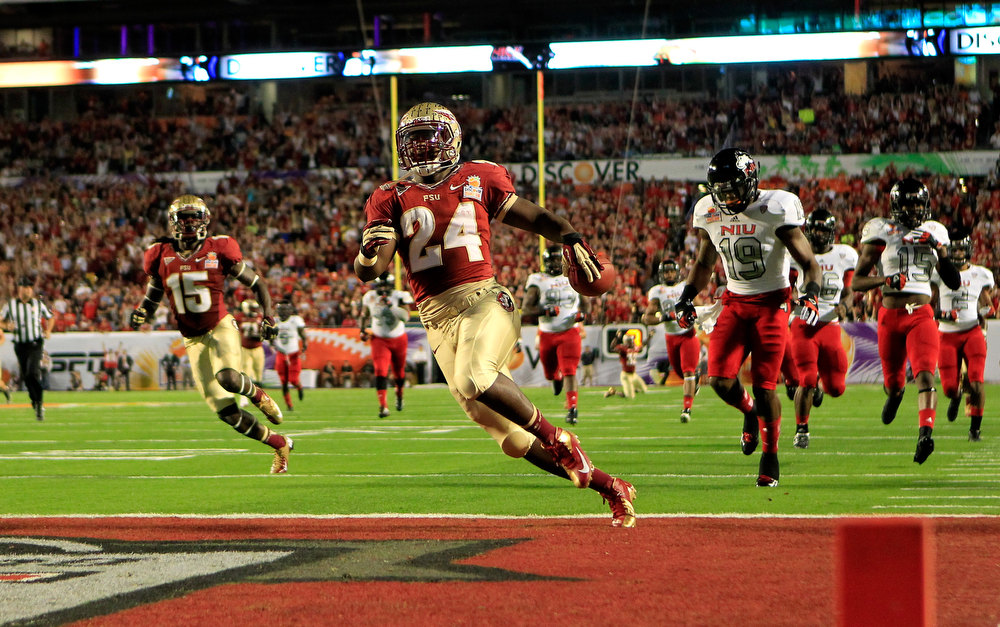 . Terrance Smith #24 of the Florida State Seminoles scores a 60-yard rushing touchdown in the first quarter against the Northern Illinois Huskies during the Discover Orange Bowl at Sun Life Stadium on January 1, 2013 in Miami Gardens, Florida.  (Photo by Chris Trotman/Getty Images)