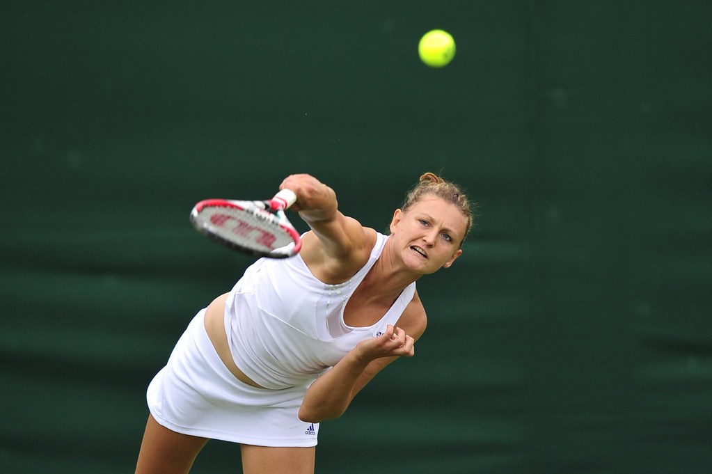 . Britain\'s Samantha Murray serves against Italy\'s Camila Giorgi during their women\'s first round match on day one of the 2013 Wimbledon Championships tennis tournament at the All England Club in Wimbledon, southwest London, on June 24, 2013.  GLYN KIRK/AFP/Getty Images