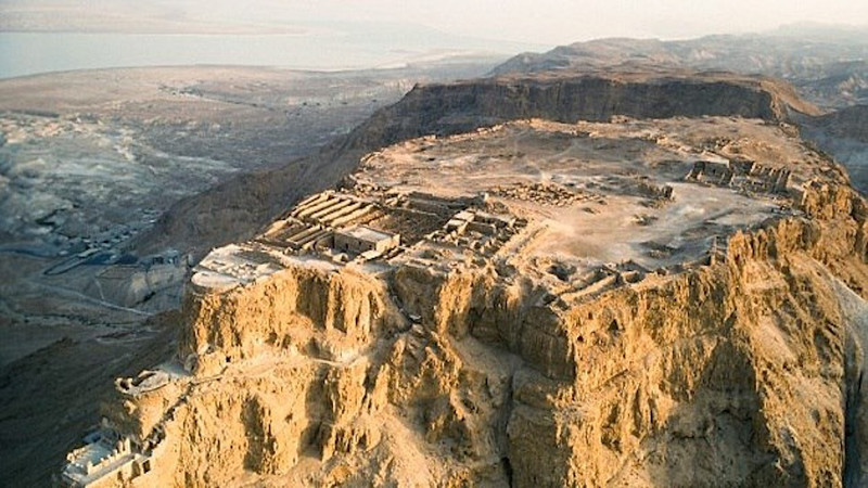 Video # 12 -- Masada with Barney of Guided Tours of Israel  http://ray-penny.smugmug.com/Vacation-2010-and-2011/Path-of-the-Ancient-Cultures/Video/11048677_3328dK#!i=1405853376&k=cwWMNsJ&lb=1&s=L    Masada (Hebrew for fortress), is situated atop an isolated rock cliff at the western end of the Judean Desert, overlooking the Dead Sea. It is a place of gaunt and majestic beauty.  On the east the rock falls in a sheer drop of about 450 meters to the Dead Sea (the lowest point on earth, some 400 m. below sea level) and in the west it stands about 100 meters above the surrounding terrain. The natural approaches to the cliff top are very difficult.  The fortress where Jews martyred themselves rather than become slaves to the Roman Empire. Masada is a UNESCO world heritage site and is definitely worth a visit if you are in Israel.